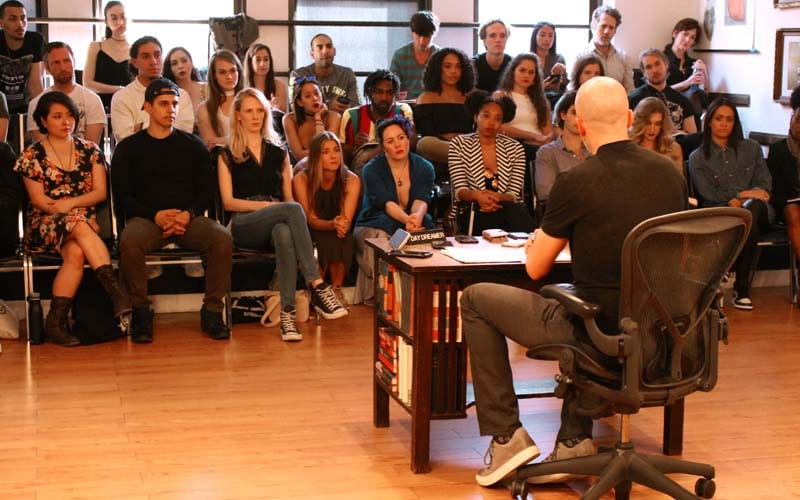 this image is from the maggie flanigan studio acting program. students are in class at the studio as part of the acting program for serious actors. Students are with charlie Sandlan who is addressing the students at the end of the first year of the two year program.