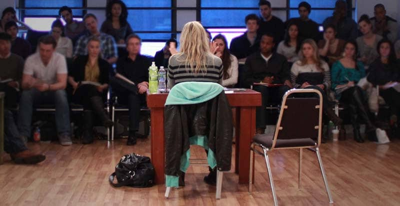 kate lacie facing students in the business class for actors