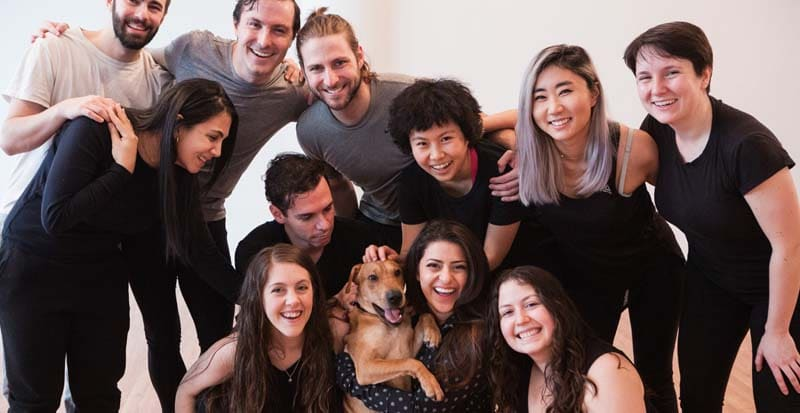 students in a group photo at drama school in new york