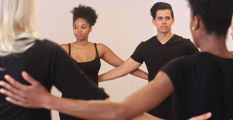 actors in movement class at maggie flanigan studio rehearse together